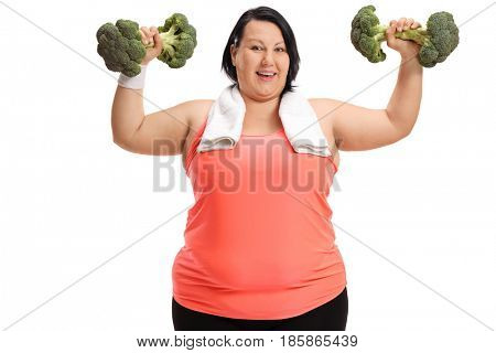 Overweight woman exercising with broccoli dumbbells isolated on white background