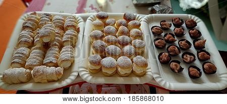 Puff pastry cannols and chantilly pastries filled with sugared cream