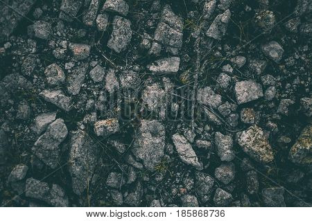 Rock mountain floor background in vintage style. Texture of stones. Abstract texture and background for designers. Closeup view of vintage stones texture and background. Dark rough texture.