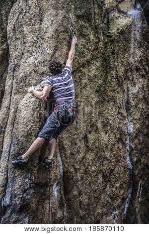 Sokoliki Poland june 22 2013: Young male climber leading a route on a rock. Sokoliki Poland