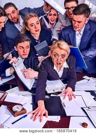 Business people office. Team people are unhappy with their leader. Intern manager does not cope with his duties. Crowd in stress. Top view.