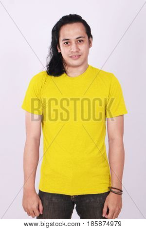Photo image of an Asian Model smiling and showing blank yellow T-Shirt front view shirt template