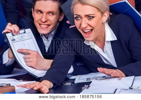 Business people office life of team people working with papers sitting table . Man denunciation on his boss . Conflict in business team .