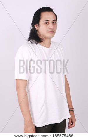 Photo image of an Asian Model smiling and showing blank white T-Shirt side view shirt template