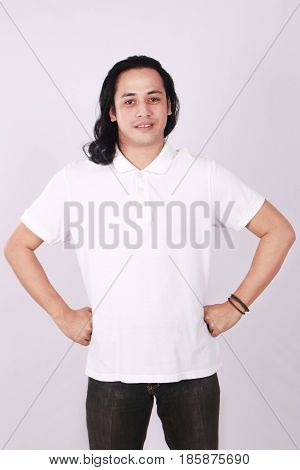 Photo image of an Asian Model smiling and showing blank white polo T-Shirt front view shirt template