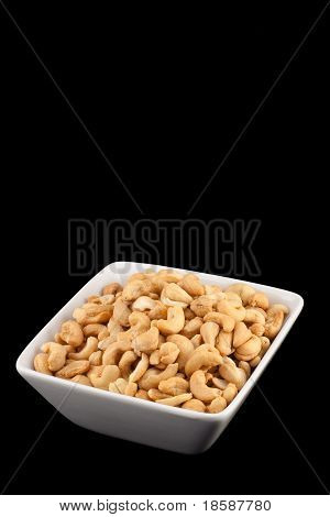 Salted Cashews In A Bowl Isolated On Black