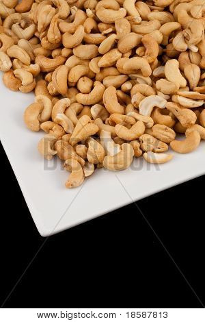 Salted Cashews On A White Plate