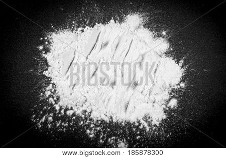 White powder on a black background.