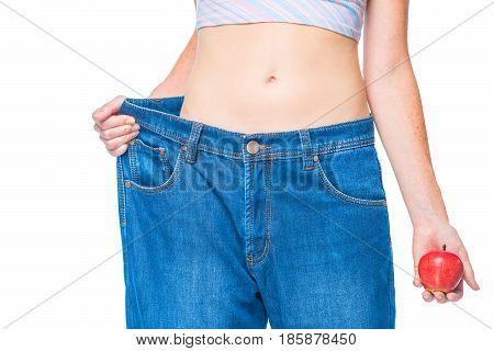 Big Size Old Jeans On Slender Hips Close-up Belly Girl