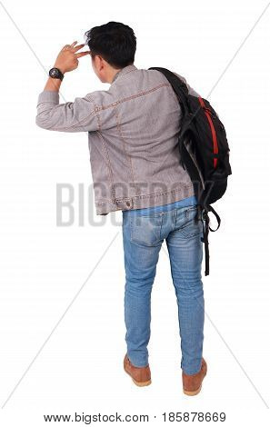 Photo image portrait of a young Asian male student standing and looking forward rear view isolated on white