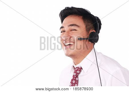 Photo image portrait of a cute young Asian male call center operator with headset on his head isolated on white