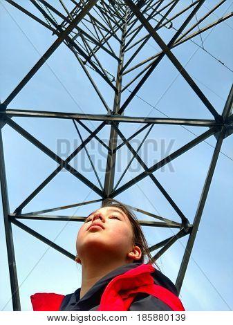 girl near a power pole