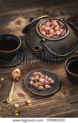 Cup Of Hot Tea And Iron Teapot