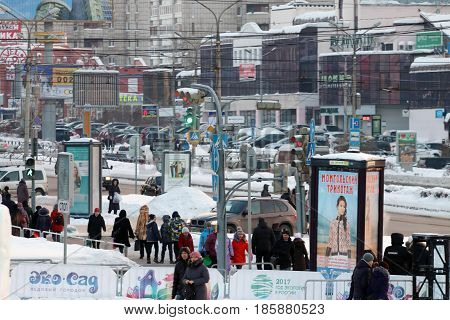 PERM RUSSIA - JAN 18 2017: Cars people move down Popov street at winter evening