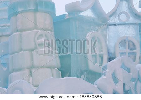 Part of ice fairytale castle with towers windows outdoor at winter frost day