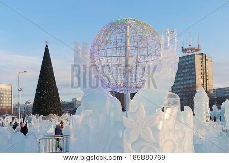 PERM RUSSIA - JAN 18 2017: Globe in hands Ice town of Perm in 2017 Ekosad - largest in Russia
