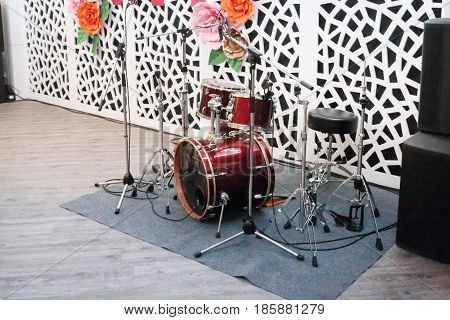 Drum kit in hall for wedding or other event with decorations