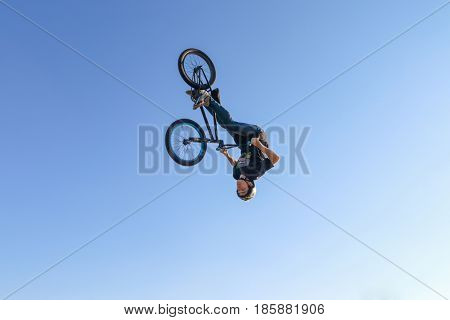 PERM RUSSIA - August 20 2016: Young man in blue jeans jumps during the event aeromat jump championship of Perm Krai