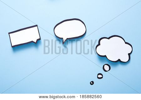 Creative ideas concept. Blank speech bubbles handcrafted on white background, top view, copy space for text