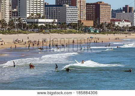 Visitors On Beach Agaist City Skyline In Durban