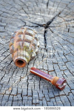 Old Hand Grenade on wood background for your desing