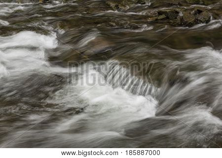 A closeup of river rapids during spring.