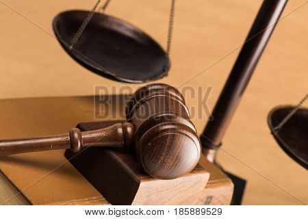 Closeup of Gavel on Books with Scale on Background