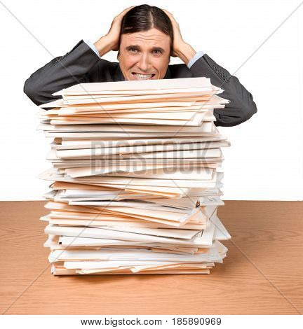 Portrait of a Desperate Employee Behind a Stack of Folders