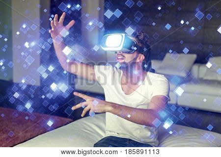 Young casual man playing on VR glasses with glowing tiles indoors