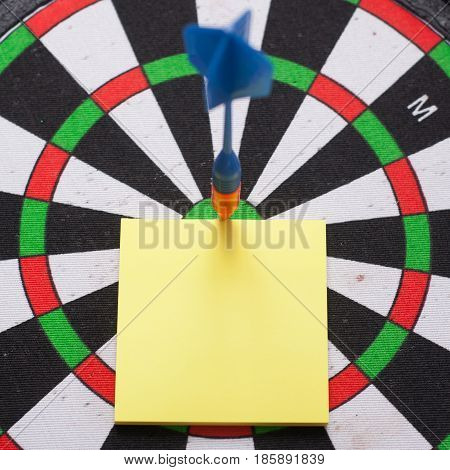 Dart Hit The Center Of The Target And Attaches The Sticker,