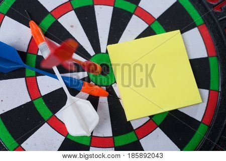 Dart hit the center of the target and attaches the sticker, the concept of achieving goals - Darts and business