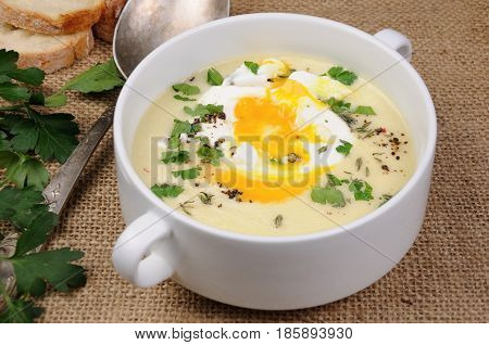 potato cream soup with bacon and poached eggs herbs spices