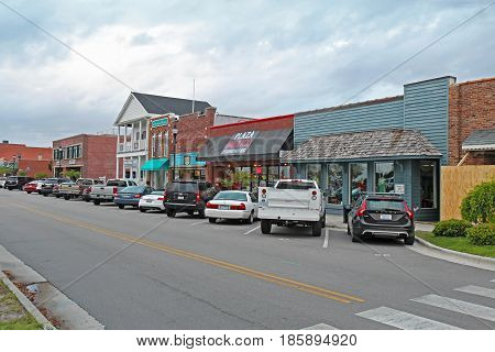 BEAUFORT NORTH CAROLINA - APRIL 18 2017: Businesses on Front Street in downtown Beaufort the third-oldest town in the state rated as