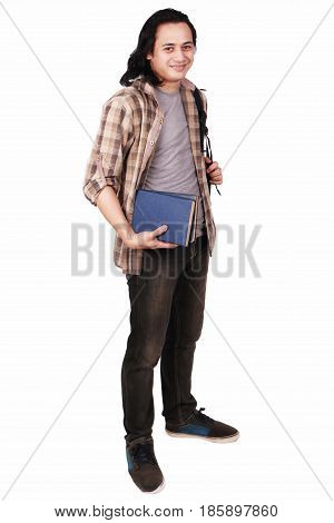 Photo image portrait of a cute young Asian male student with long hair looking to camera standing and smiling while holding books full body portrait isolated on white