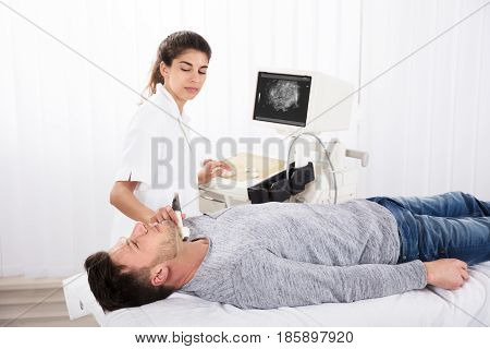 Man Undergoing The Medical Ultrasound Examination In Clinic
