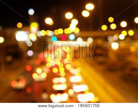 defocused colorful car lights and street lamp bokeh, blurred traffic on the road of city at night abstract background