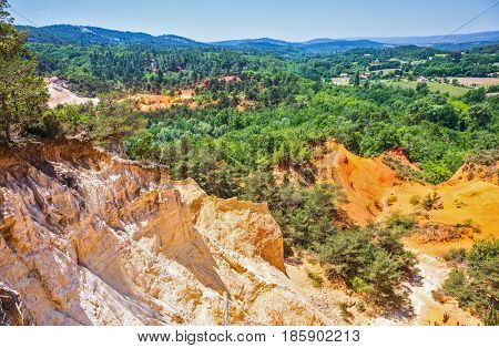Languedoc - Roussillon, Provence, France. The reserve is in place on the career of ocher mining. Orange and red picturesque hills