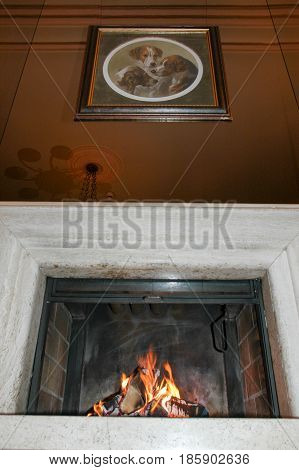 Leukerbad Switzerland - 2 October 2002: Fire burning in a fireplace of a hotel
