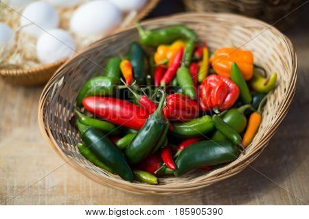 High angle view of bell peppers in wicker basket on table
