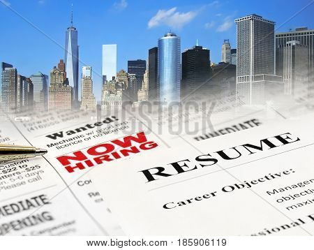 Closeup of Resume on Newspaper Career Opportunity Ad on cityscape background