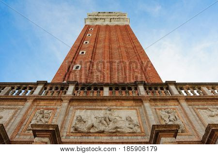 Close view of St Mark's Campanile St Theodore of Amasea statue and Biblioteca in Venice Italy. These buildings are the most recognizable symbols of the city.