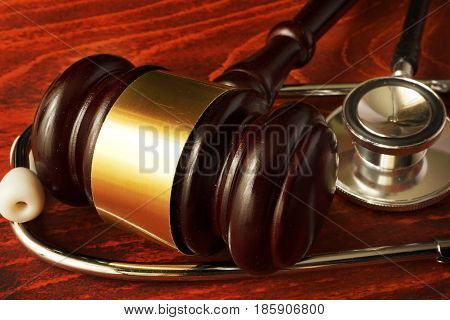 Medical negligence. Gavel and stethoscope. Malpractice concept.