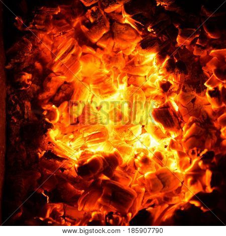 Hot coals in the fire. Abstract background of burning ember.