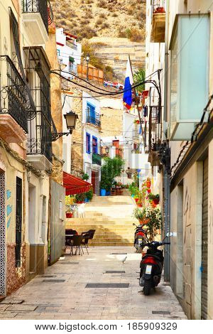 Old uphill street in Alicante town, Spain