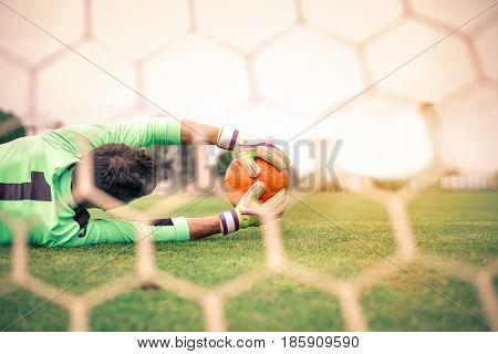 Goalkeeper catching a ball