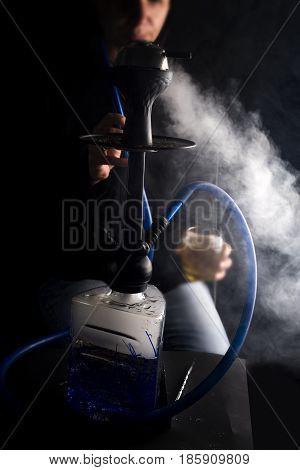 Man Smokes Fruit Hookah
