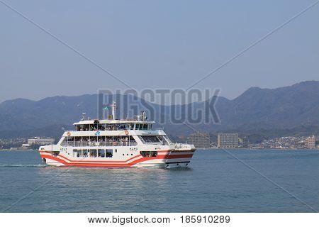 HIROSHIMA JAPAN - MARCH 19, 2017: Unidentified people travel by Miyajima Ferry.