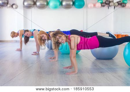 women exercise class with balance balls