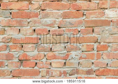 texture of the old walls of bright red brick