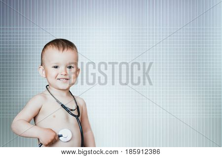 Sweet Baby With Stethoscope On A White Background. Adorable Baby Boy On White